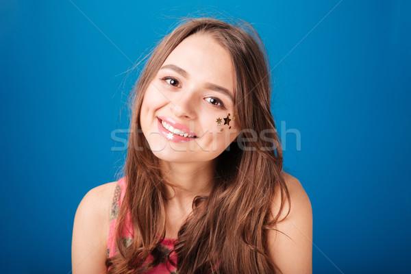 Bastante feliz mulher jovem estrela decoração Foto stock © deandrobot