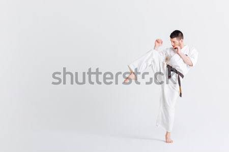 Playful woman in bathrobe with towel on head sending kiss Stock photo © deandrobot