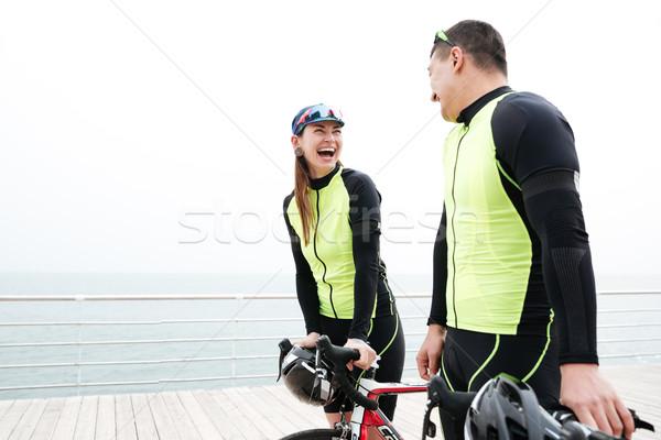Stock fotó: Pár · biciklik · beszél · nevet · móló · boldog