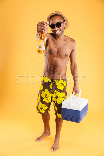 Vrolijk jonge man hoed zonnebril bierfles Stockfoto © deandrobot