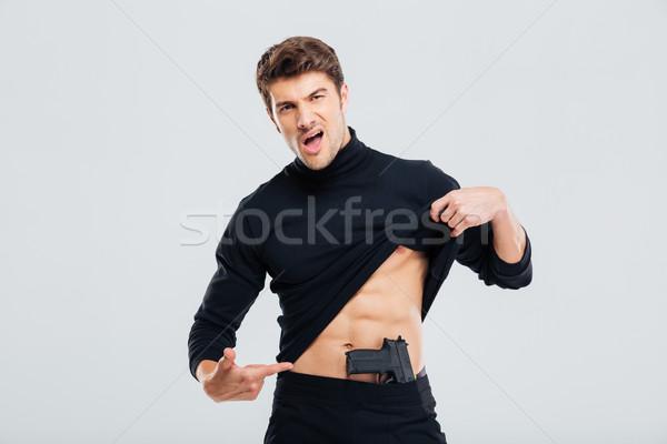 Moço posando pistola homem segurança morte Foto stock © deandrobot