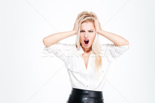 Young businesswoman covering her ears and shouting Stock photo © deandrobot