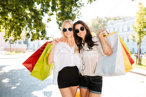 Two young women with shopping bags on the city street Stock photo © deandrobot