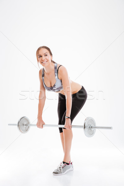 Full length fitness woman with barbell Stock photo © deandrobot