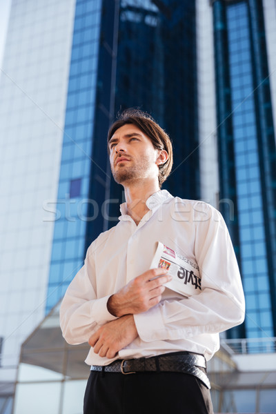 Strict businessman in city Stock photo © deandrobot