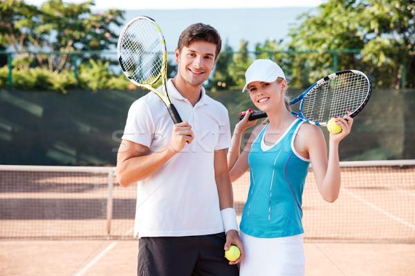 счастливым теннис пару суд глядя камеры Сток-фото © deandrobot
