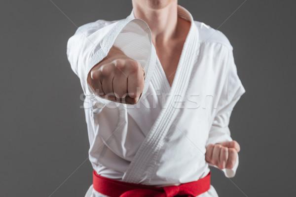 Foto guapo práctica karate kimono Foto stock © deandrobot