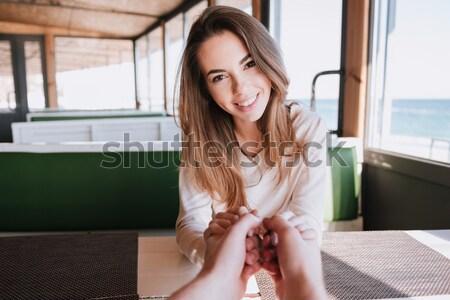счастливым женщину дата кафе морем сидят Сток-фото © deandrobot