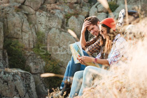 Macera çift harita oturma kız Stok fotoğraf © deandrobot