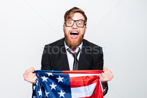 Screaming business man with flag Stock photo © deandrobot