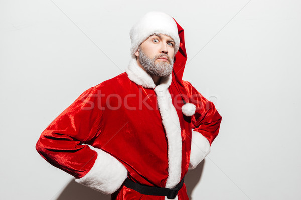 Confident strict man santa claus standing with hands on hips Stock photo © deandrobot