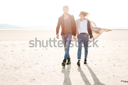 Romantic young couple walking on the seaside in autumn Stock photo © deandrobot