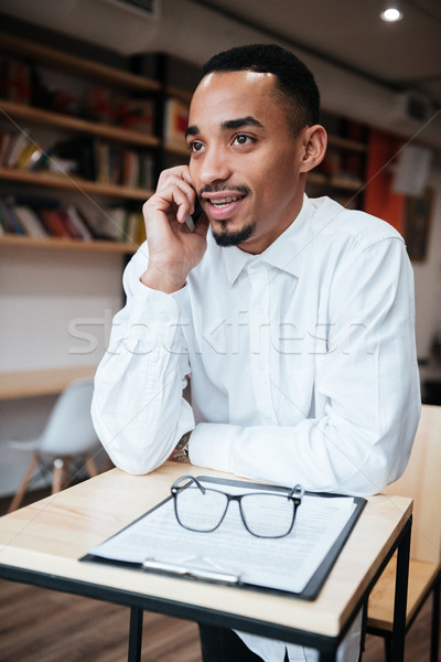 Stock photo: Handsome african businessman talking by phone.