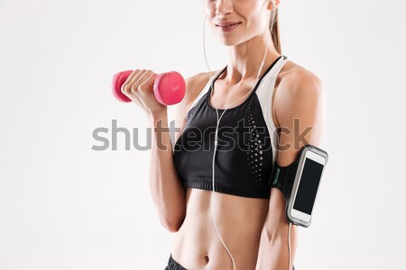 Vista lateral mulher pesado barbell Foto stock © deandrobot