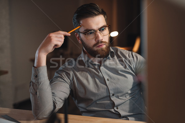 молодые бородатый веб дизайнера рабочих поздно Сток-фото © deandrobot