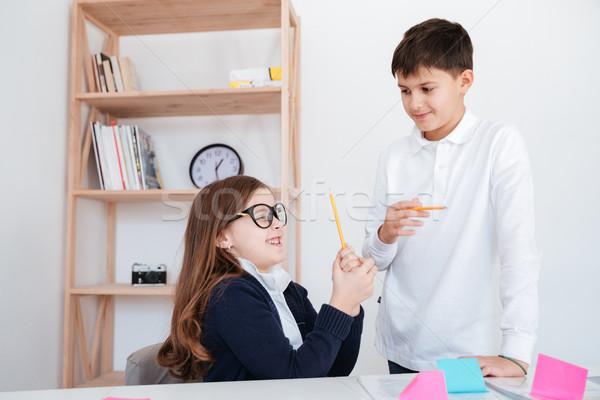 Engraçado little girl irmão ensino óculos Foto stock © deandrobot