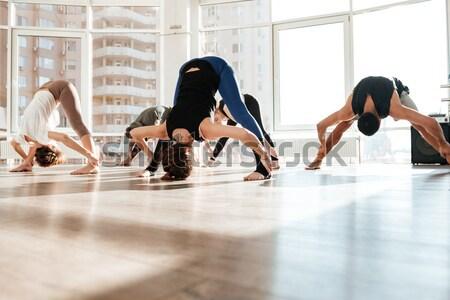 Persone gruppo bilanciamento mani yoga studio Foto d'archivio © deandrobot