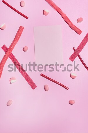 Top view of red sugar candies and lollies Stock photo © deandrobot