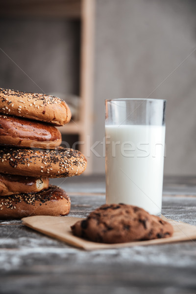 Pastries on dark wooden table with milk and cookie Stock photo © deandrobot