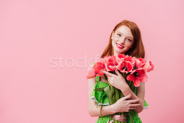 Souriant gingembre femme bouquet fleurs Photo stock © deandrobot
