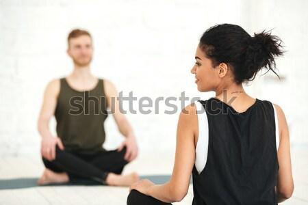 Masculina yoga instructor sesión círculo grupo Foto stock © deandrobot