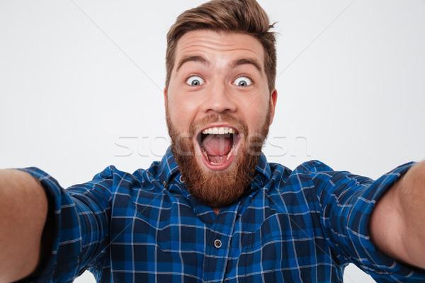 Photos heureux hurlant barbu homme Photo stock © deandrobot