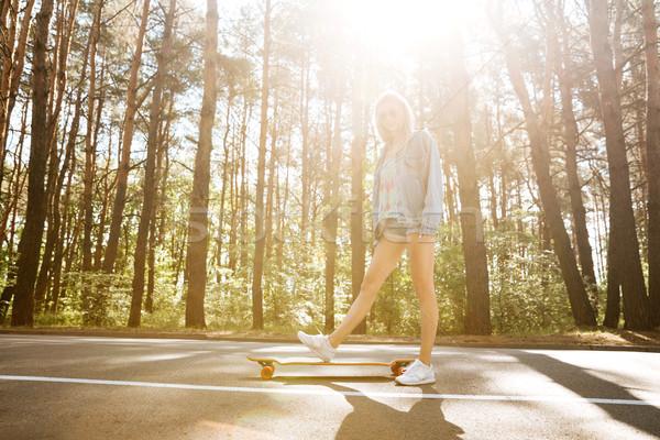 молодые красивая женщина скейтборде улице фотография глядя Сток-фото © deandrobot