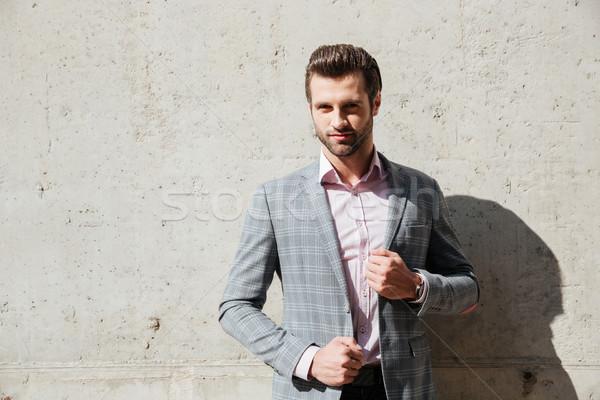 Portrait sérieux bel homme veste permanent regarder Photo stock © deandrobot