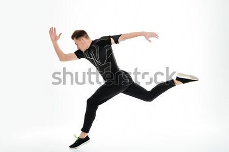 вид сбоку портрет здорового спортсмен запустить Сток-фото © deandrobot