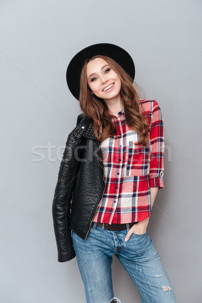 Smiling lovely woman wearing plaid shirt and leather jacket Stock photo © deandrobot