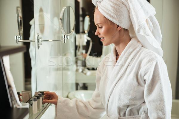 Nő fürdőköpeny néz kozmetika tükör fiatal Stock fotó © deandrobot
