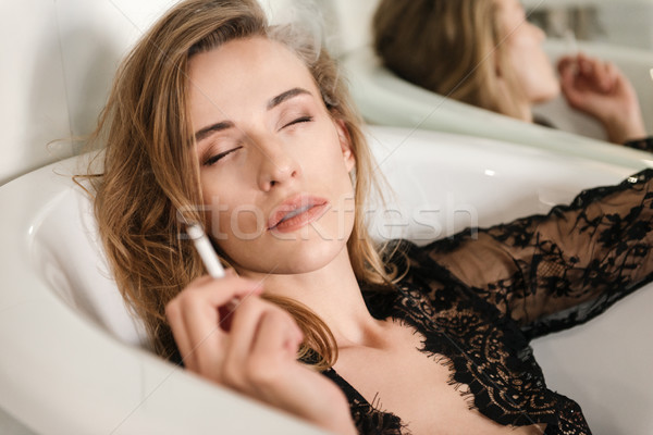 Portrair of smoking in bath woman Stock photo © deandrobot