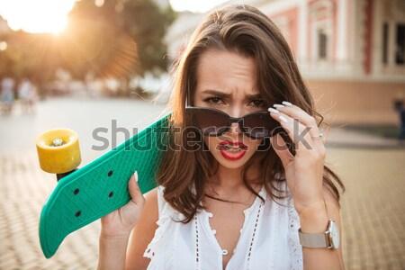 улыбаясь скейтборде улице фотография Сток-фото © deandrobot