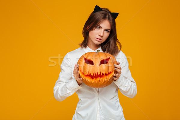 Serious young woman dressed in crazy cat halloween costume Stock photo © deandrobot