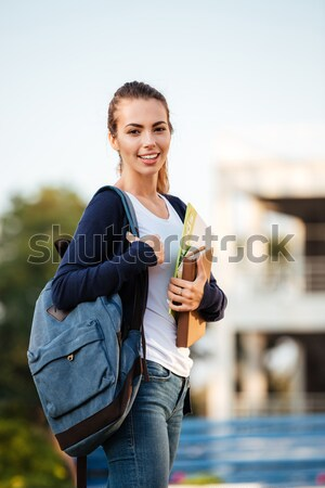 Portrait of a joyful brown-haired student girl standing Stock photo © deandrobot