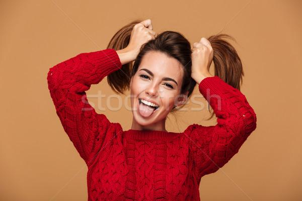 Közelkép vicces fiatal fiatal lány mutat nyelv Stock fotó © deandrobot