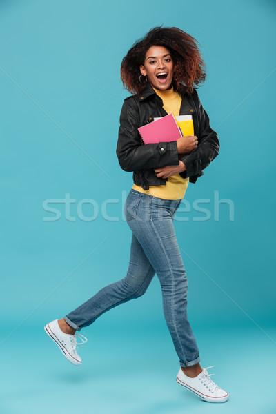 Imagem alegre africano mulher jaqueta de couro Foto stock © deandrobot