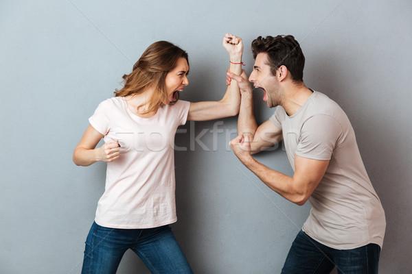 Portret woedend argument vechten grijs Stockfoto © deandrobot