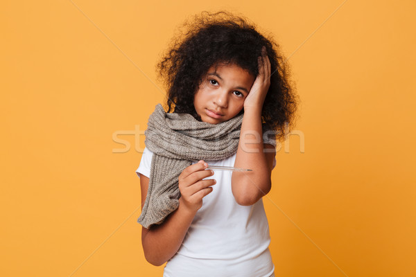 Close up portrait of a sick afro american girl Stock photo © deandrobot