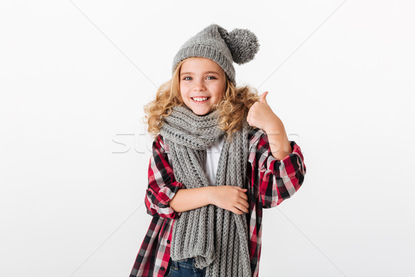 Portrait of a smiling little girl dressed in winter hat Stock photo © deandrobot