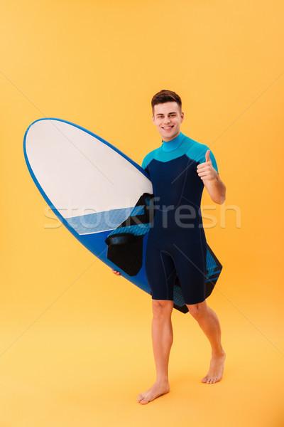 изображение счастливым Surfer ходьбе доска для серфинга Сток-фото © deandrobot
