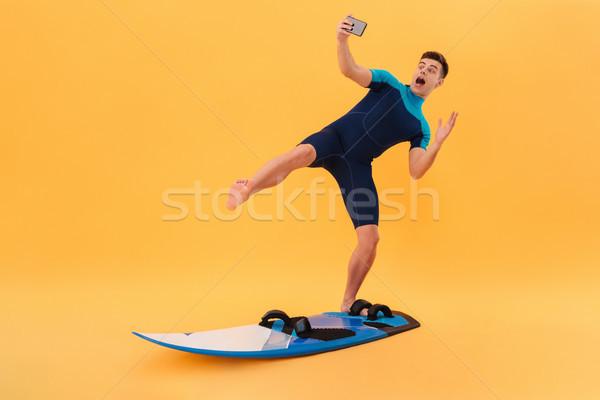 фотография Surfer доска для серфинга смартфон Сток-фото © deandrobot