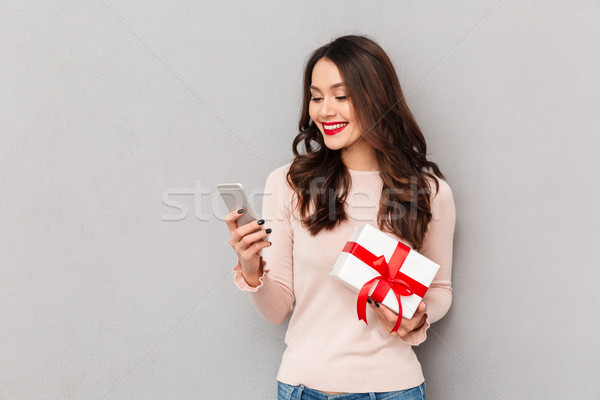 Stock photo: Portrait of attractive brunette female 30s winning silver new sm