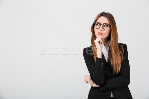 Portrait of a thoughtful businesswoman dressed in suit Stock photo © deandrobot