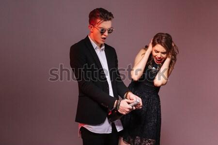 Mosolyog férfi punk okostelefon nő szeretet Stock fotó © deandrobot