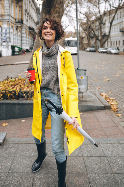 Cheerful pretty young woman dressed in rubber boots Stock photo © deandrobot