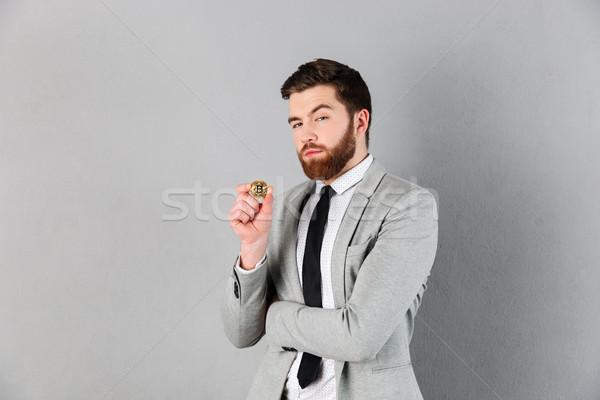 Portrait of a confident businessman dressed in suit Stock photo © deandrobot