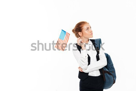 Pleased gigner student woman with backpack holding laptop computer Stock photo © deandrobot