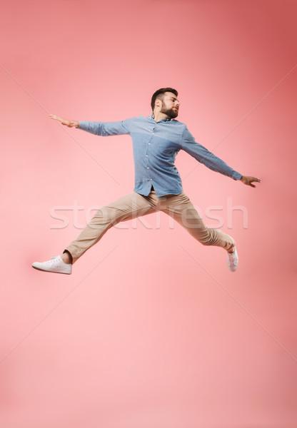 Gioioso giovane jumping successo Foto d'archivio © deandrobot