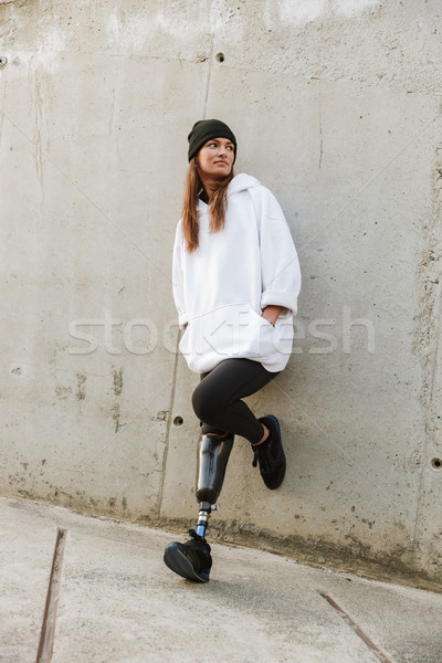 Photo of caucasian disabled girl with bionic leg in casual wear, Stock photo © deandrobot